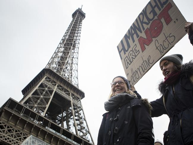 Anti-Trump protesters rally near the Eiffel Tower in Paris. Picture: AP Photo/Kamil Zihnioglu
