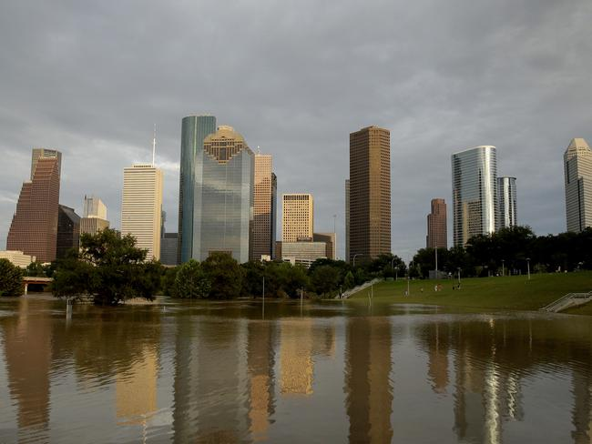 Dowtown Houston is reflected in flooded Buffalo Bayou. Picture: AP