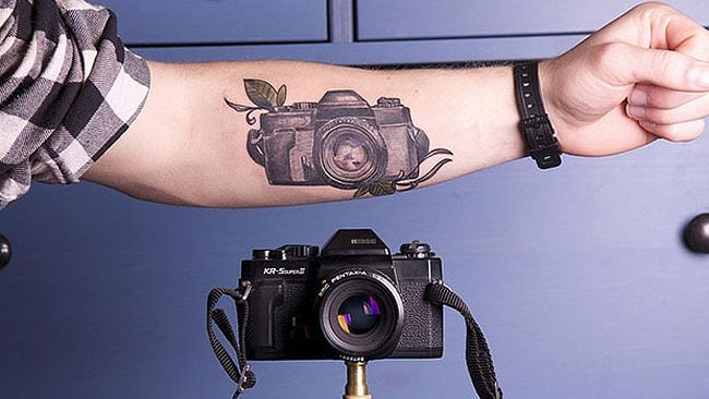 Photography tattoos: never leave home without your camera. Photo: Inked. Explored! by Klem Photo