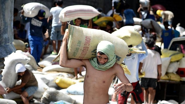 Residents loot water-damaged sacks of rice from a warehouse in Tacloban in the eastern Philippine island of Leyte.