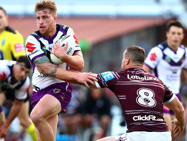 Cameron Munster gets past Manly's Brenton Lawrence at the weekend. Picture: Gregg Porteous