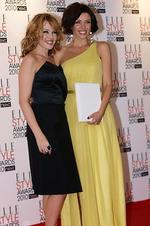 (FILES) Photo taken on February 22, 2010 shows Australian pop star Dannii Minogue (R) with her sister Kylie (L) at the 2010 Elle Awards in central London. Australian pop personality Dannii Minogue became a mum for the first time, giving birth to a baby boy at the hospital. The 38-year-old and her boyfriend Kris Smith, a former England rugby league player, say they are &thrilled& to announce the arrival of Ethan Edward Smith on July 5, 2010. Minogue, a judge on British TV show The X Factor and her pop singer sister Kylie will head home later this month to meet her new nephew. AFP Photo/FILES/ Max Nash