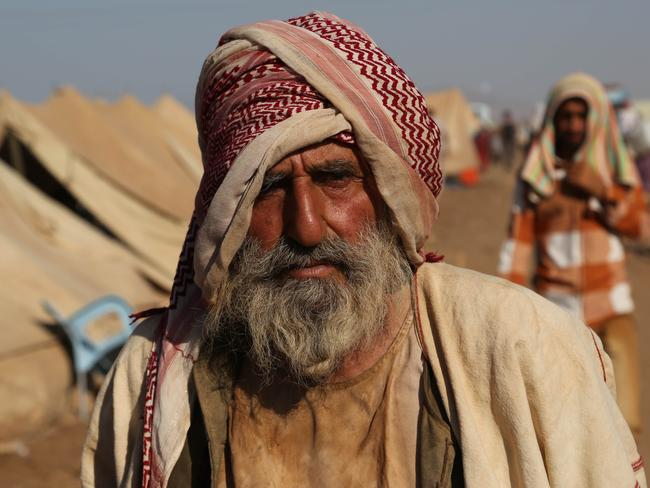 An elderly Iraqi Yazidi man arrives at Nowruz camp, in Syria. Pic: AP.