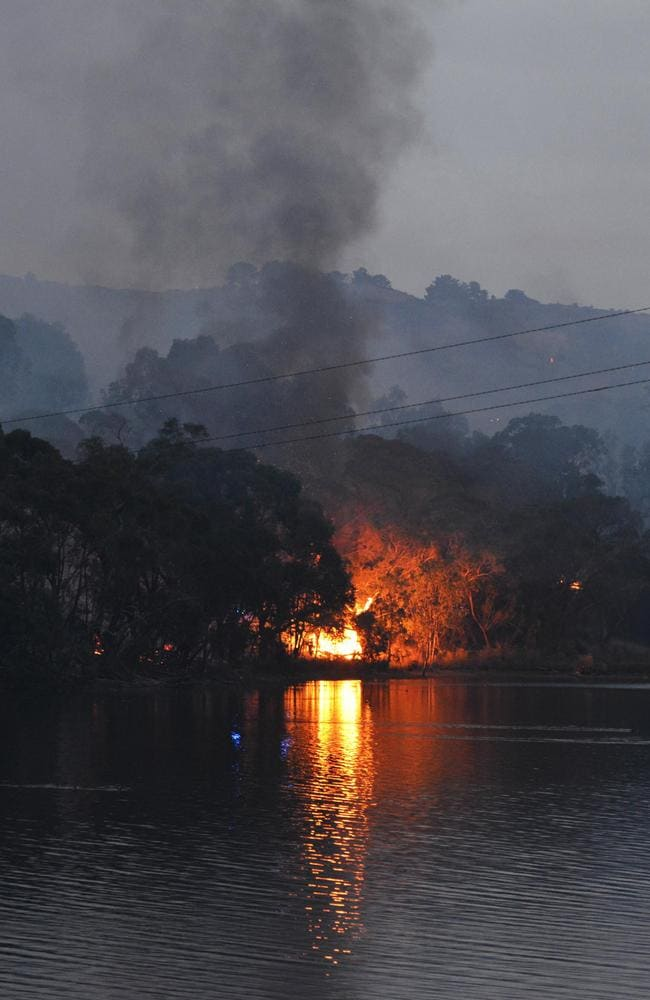Growing inferno ... The bushfire burns through scrub near Gumeracha in the Adelaide Hills. Source: AFP/ BRENTON EDWARDS