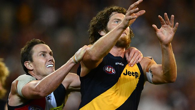 Jason Blake gives away a free kick for holding Ty Vickery. Picture: Wayne Ludbey