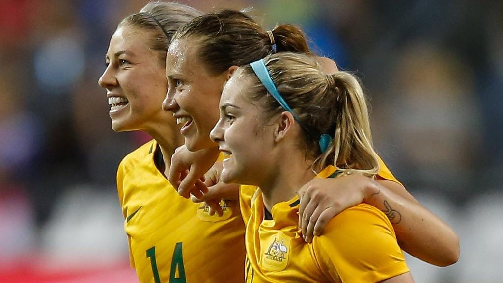 SEATTLE, WA — JULY 27: L to R: Alanna Kennedy #14, Emily Van Egmond #10, and Ellie Carpenter #21 of Australia celebrate after defeating the United States 1-0 during the 2017 Tournament of Nations at CenturyLink Field on July 27, 2017 in Seattle, Washington. Otto Greule Jr/Getty Images/AFP == FOR NEWSPAPERS, INTERNET, TELCOS & TELEVISION USE ONLY ==