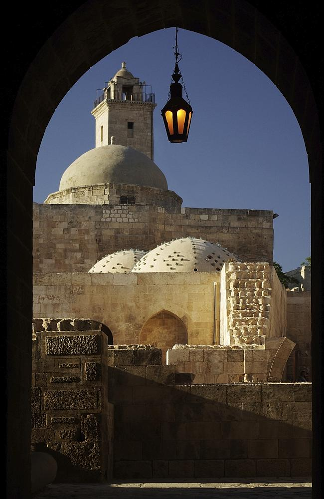Turkish bath and minaret, Aleppo, Syria.