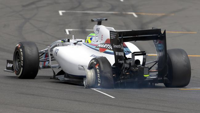Massa limps his broken Williams back to the grid.
