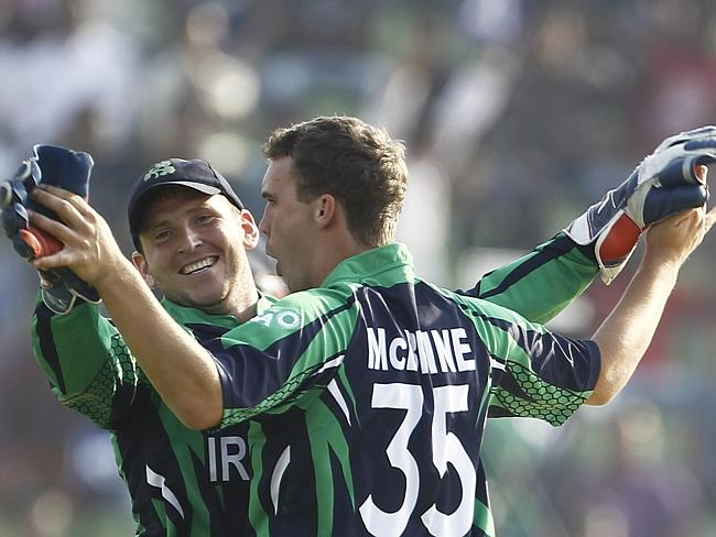 Happy St Patrick's Day ... Ireland's Andy McBrine, right, celebrates with teammate Gary Wilson after a wicket.