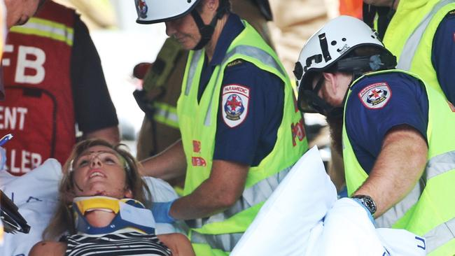 A passenger is rescued and taken away on a stretcher. Picture: Hamish Blair