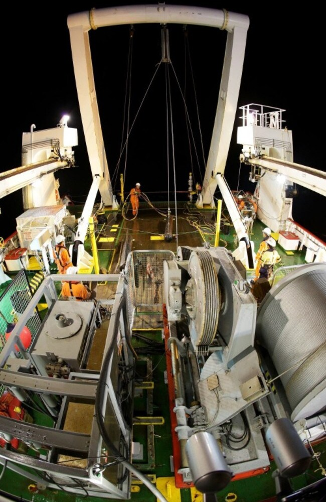 A night-time view from the stern of Fugro Discovery, which is scouring the southern Indian Ocean for flight debris. Picture: Australian Transport Safety Bureau/Chris Beerens/RAN