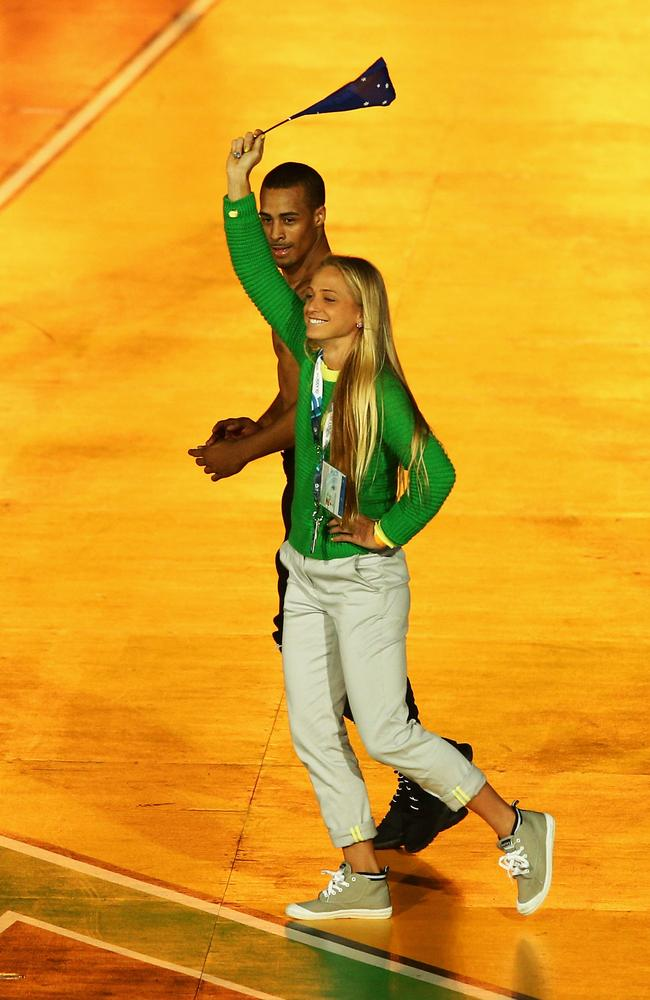 Genevieve LaCaze crashes the stage during Kylie Minogue's performance at the Commonwealth Games closing ceremony.