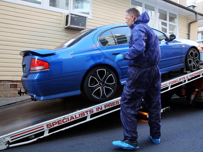 Former detective Glen McNamara's car being taken away from Kogarah Police Statio Picture Craig Greenhill