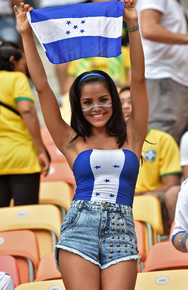 A Honduras fan cheers for her team before the start of the Group E football match between Honduras and Switzerland at the Amazonia Arena in Manaus.