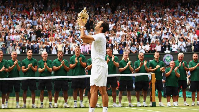 Federer celebrates victory with the Wimbledon trophy. Picture: Clive Brunskill/Getty Images