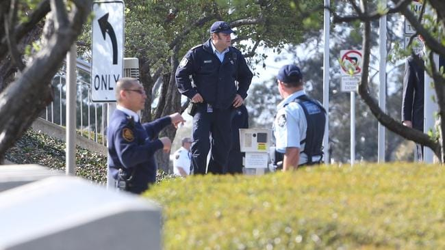 Beefed up ... Politicians returned to increased security at Parliament House in Canberra today.