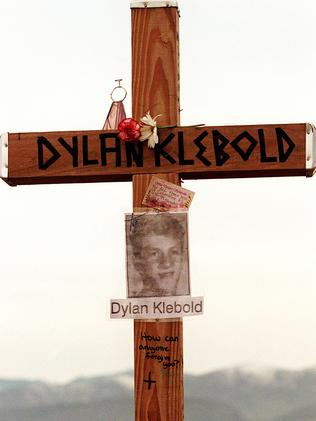 "A cross with shooter Dylan Klebold's name and the message ""how can anyone forgive you?"""