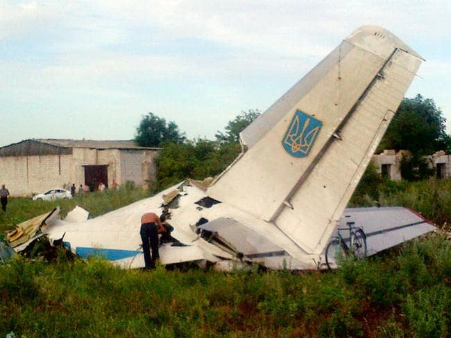 Conflict ... A July 14 image of a Ukrainian AN-26 transport aircraft shot down by pro-Russian rebels near Davido-Nikolsk. Picture: AFP
