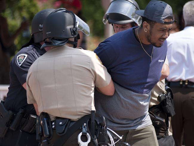 Police detain a protester following a march in Ferguson. Picture: AP