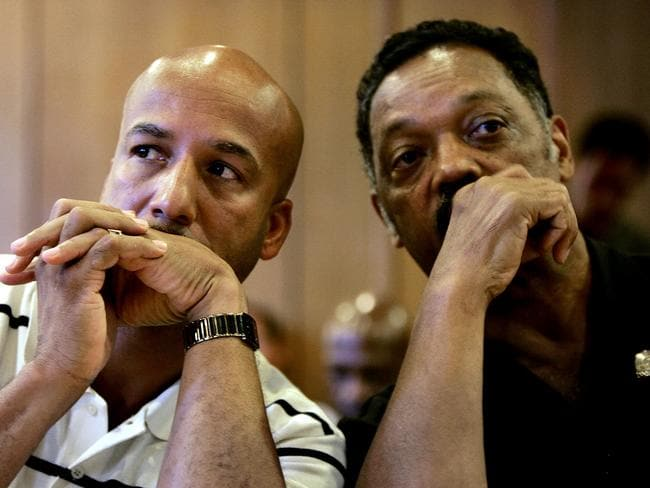 Public figure ... New Orleans Mayor Ray Nagin (L) and Reverend Jessie Jackson converse during a city council meeting at New Orleans International Airport in 2005.