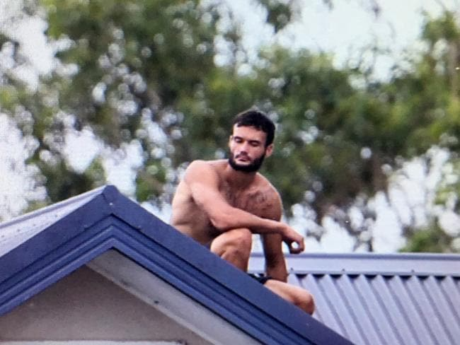 Police are negotiating with the man on the roof of a house in Tighes Hill. Picture: Peter Lorimer