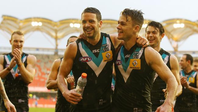 Port skipper Travis Boak celebrates game 150 - with a win - with teammate Robbie Gray. Picture: Getty Images