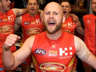 Suns player Gary Ablett celebrates following his 300th game, the round 15 AFL match between the Gold Coast Suns and the North Melbourne Kangaroos at Metricon Stadium on the Gold Coast, Saturday, July 1, 2017. (AAP Image/Dave Hunt) NO ARCHIVING, EDITORIAL USE ONLY
