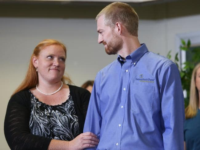 Dr. Kent Brantly stands with his wife, Amber after his release from hospital. Picture: Jessica McGowan