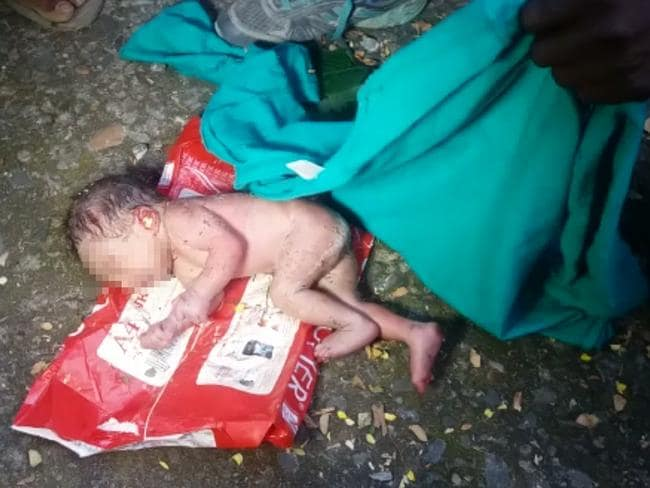 A newborn baby girl was found dumped in garbage vat swarmed by ants in Madhya Pradesh, India. Picture: Caters