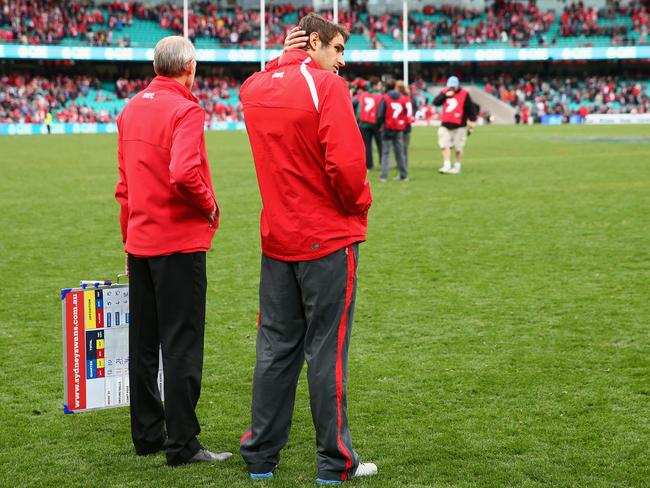 Josh Kennedy looks on after injuring his leg during Sydney's win against St Kilda.