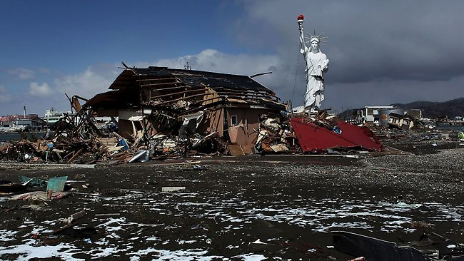 A replica of the Statue of Liberty stands among rubble and debris in Ishinomaki, Japan / Getty Images