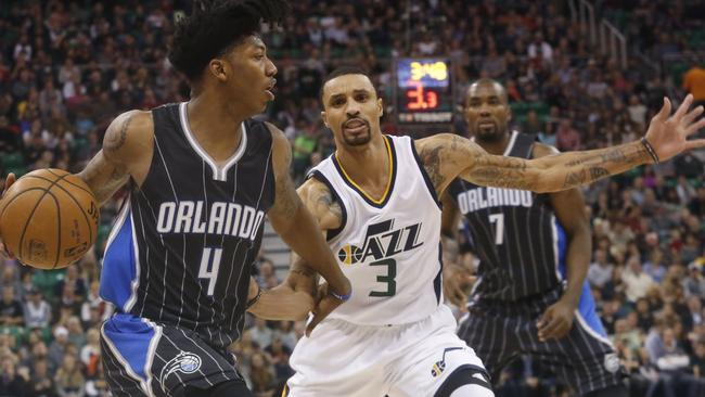 Orlando Magic's Elfrid Payton (4) looks to pass as Utah Jazz's George Hill (3).