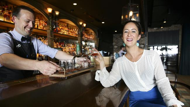 Glenn Wheeler serves Alicia Hawkins a paddle of flavoured whiskeys at Nola, Barangaroo. Picture: Justin Lloyd.