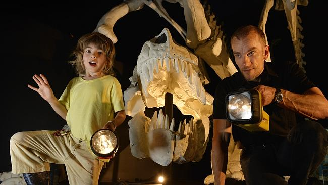 Nazario Whyte (5) and paleontologist Mikael Siversson preview the new dinosaur exhibition.