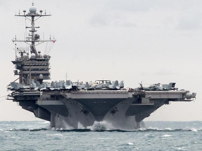 Aircraft carrier USS Harry S. Truman is headed to the Middle East with five escort warships. Picture: U.S. Navy