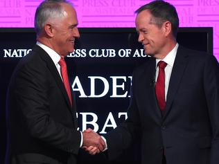 Prime Minister Malcolm Turnbull (left) and Opposition Leader Bill Shorten shake hands as they arrive for the leaders' debate at the National Press Club in Canberra, Sunday, May, 29, 2016. (AAP Image/Tracey Nearmy) NO ARCHIVING