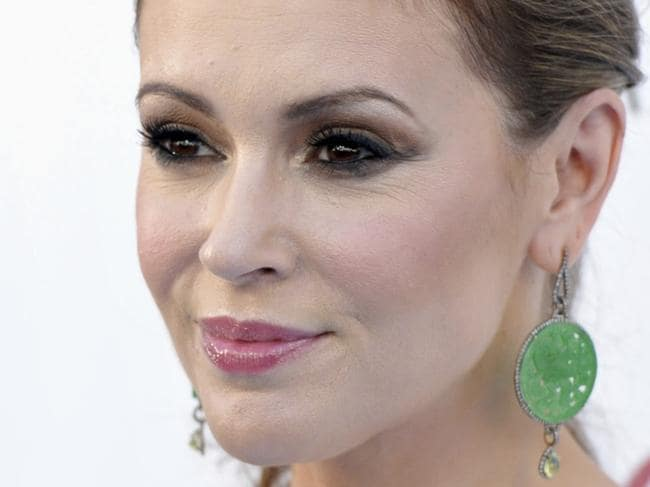"FILE - In this May 19, 2013, file photo, Alyssa Milano arrives at the Billboard Music Awards at the MGM Grand Garden Arena in Las Vegas. Thousands of women responded to Milano's call on Sunday, Oct. 16, 2017, to tweet ""me too"" in order to raise awareness of sexual harassment and assault following the recent revelation of decades of allegations of sexual misconduct by movie mogul Harvey Weinstein. (Photo by John Shearer/Invision/AP, File)"