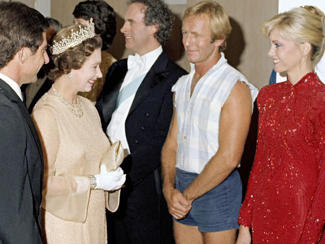 The Queen meets Paul Hogan and Olivia Newton-John after a charity concert at the Sydney Opera House in 1980. Picture: National Archives.