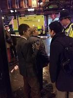 Witnesses gather outside the Apollo Theatre, in London's Shaftesbury Avenue. Picture: JamieCutter_/Twitter