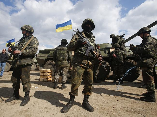 Discontent ... Ukrainian army troops receive ammunition on the outskirts of Izyum, Eastern Ukraine. Picture: Sergei Grits