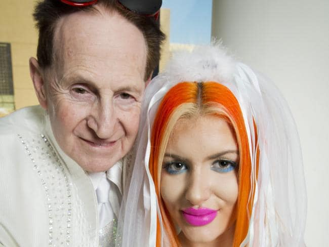 Tied the knot ... Geoffrey Edelsten and Gabi Grecko pose for a photo after their low-key Melbourne wedding. Picture: Nathan Dyer