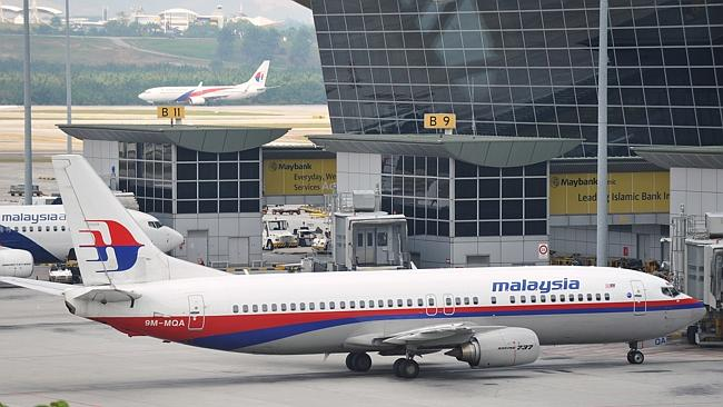 A Malaysia Airlines passenger jet sits on the tarmac at a departure gate of Kuala Lumpur International Airport on March 22, 2014 in Kuala Lumpur, Malaysia.
