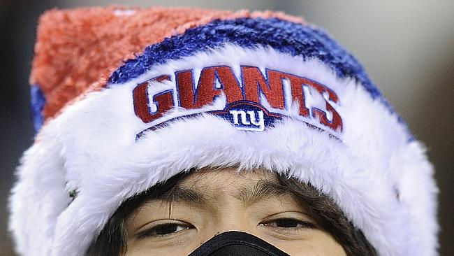 A New York Giants fan is bundled against the cold.