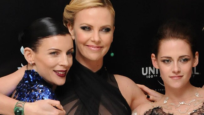 Liberty Ross, left, and Stewart shared the red carpet together at the premiere of Snow White and the Huntsman. Also with them was Charl;ize Theron. Ross played Stewart's mother in the film. Picture: Splash