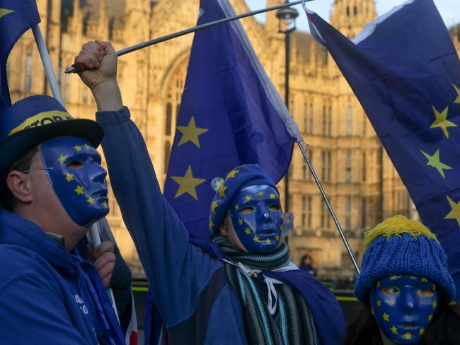 Pro-European Union, anti-Brexit demonstrators wear masks featuring the EU flag outside the Houses of Parliament in central London. Picture: AFP