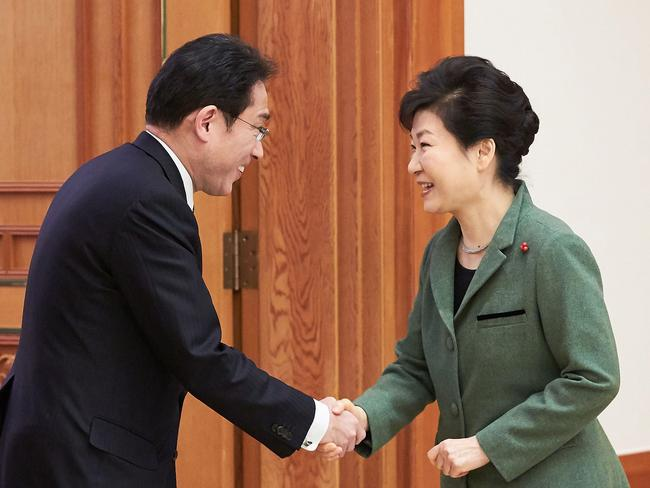 South Korea's President Park Geun-Hye (right) shakes hands with Japanese Foreign Minister Fumio Kishida before their meeting in Korea.