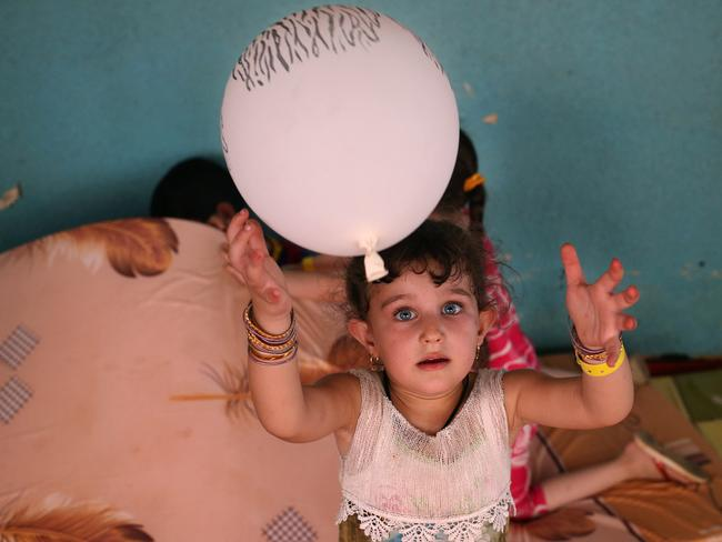 A displaced Iraqi Christian girl who fled with 2000 other Christians from Hamdania to this temporary shelter in Ainkawa, Irbil on Saturday, June 28, 2014. Photo: Hussein Malla