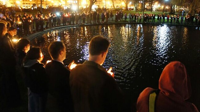 Hundreds of mourners gather at Boston Common for a candelight vigil.