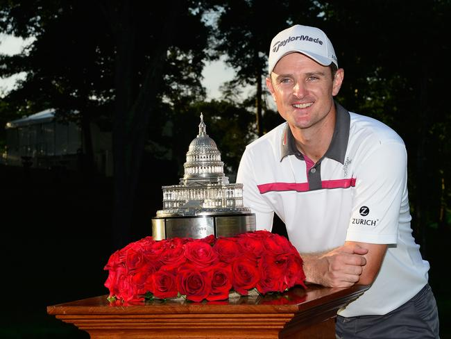 Justin Rose of England poses with the trophy after winning the Quicken Loans National.
