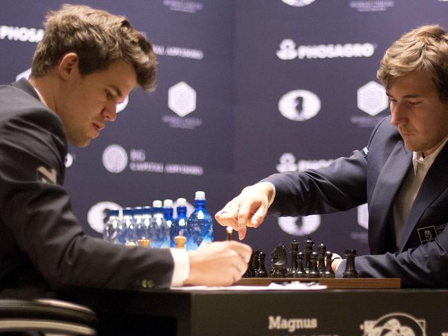 Magnus Carlsen, left, has been training in the Caribbean before the event. Picture: AP Photo/Mark Lennihan
